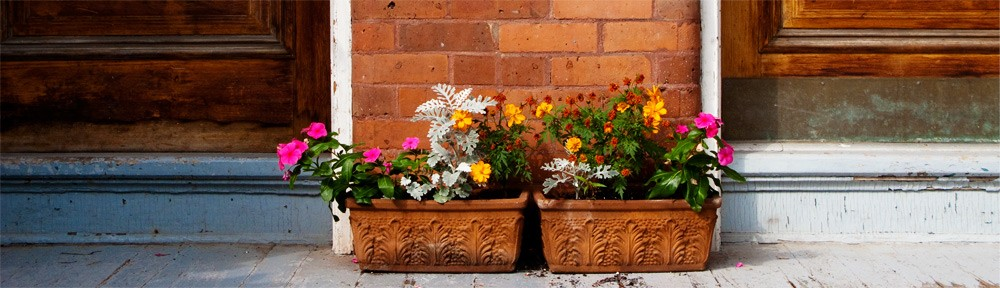 Two flower boxes on front porch